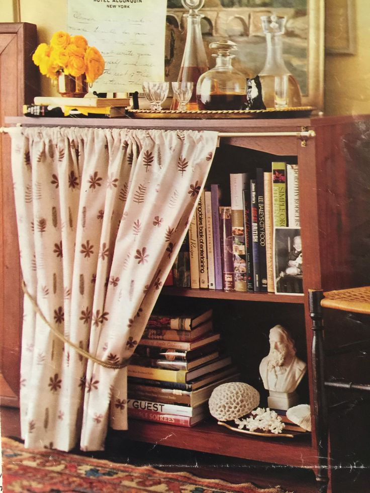 Cover The Front Of An Ugly Bookshelf With A Small Curtain