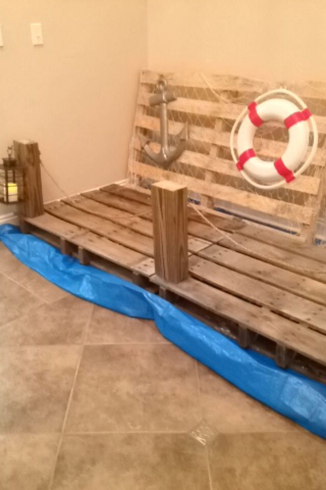 #SonTreasureIsland pier decorations using crates, nets, a cut 4x4, rope, lanterns, and boating decorations