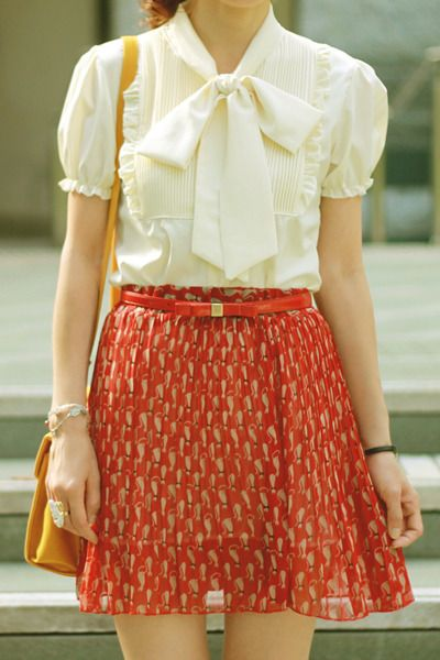 Bow blouse + printed skirt, reminds me of Zooey Deschanel