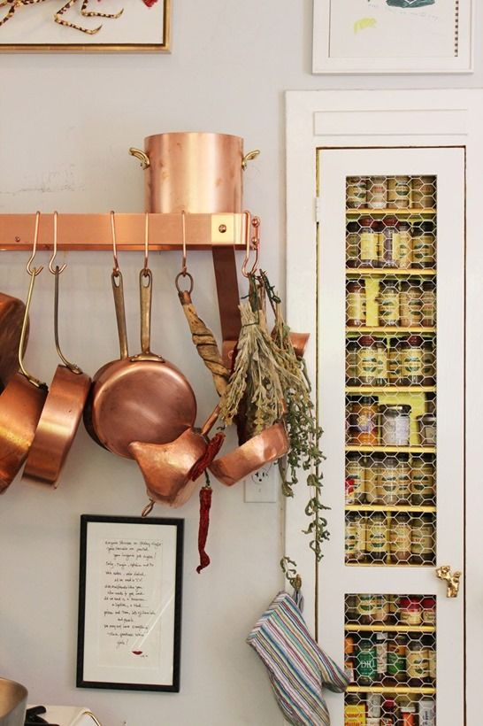 copper pots - apartment therapy via centsational girl. Note the built-in spice rack.