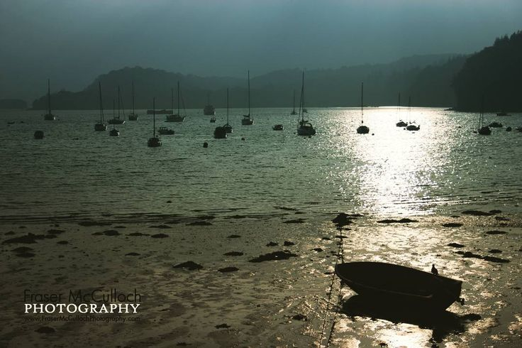 Tobermory   The sun shines through after a long day of storms in Tobermory, Scotland.   #tobermory #mull #scotland #islands #beach #storm #clouds #sun #boats #sailboat #harbour #bay #silhouette #shine #highlandsandislands #ray #backlit #rowingboat #frasermccullochphotography