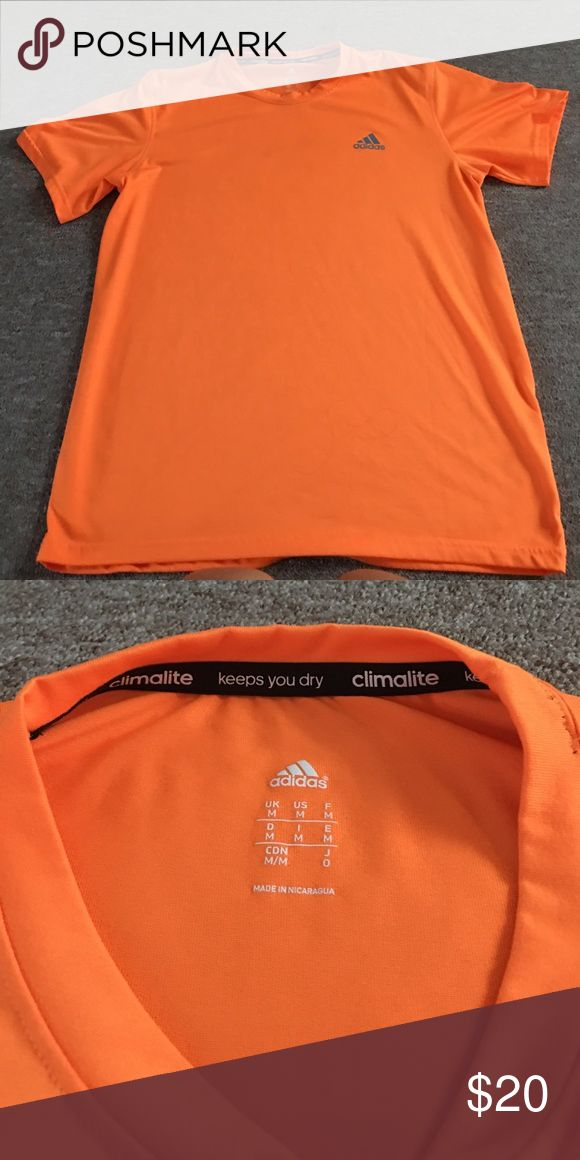 Men's Adidas Workout Shirt Orange like new without tags Adidas Workout shirt.   Made of the adidas climalite material, perfect for working out in.   Perfect condition!  no rips, tears or stains adidas Shirts Tees - Short Sleeve