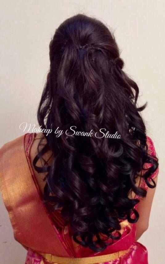 Indian bride. Bridal hairstyle. Curls. Bridal reception hair. Hair by Swank Studio. Find us at https://www.facebook.com/SwankStudioBangalore