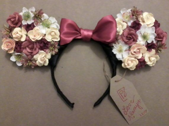 This listing is for one Minnie Mouse Floral Ear Headband. This style headband features full ears made of floral decals with Minnie Mouses red bow