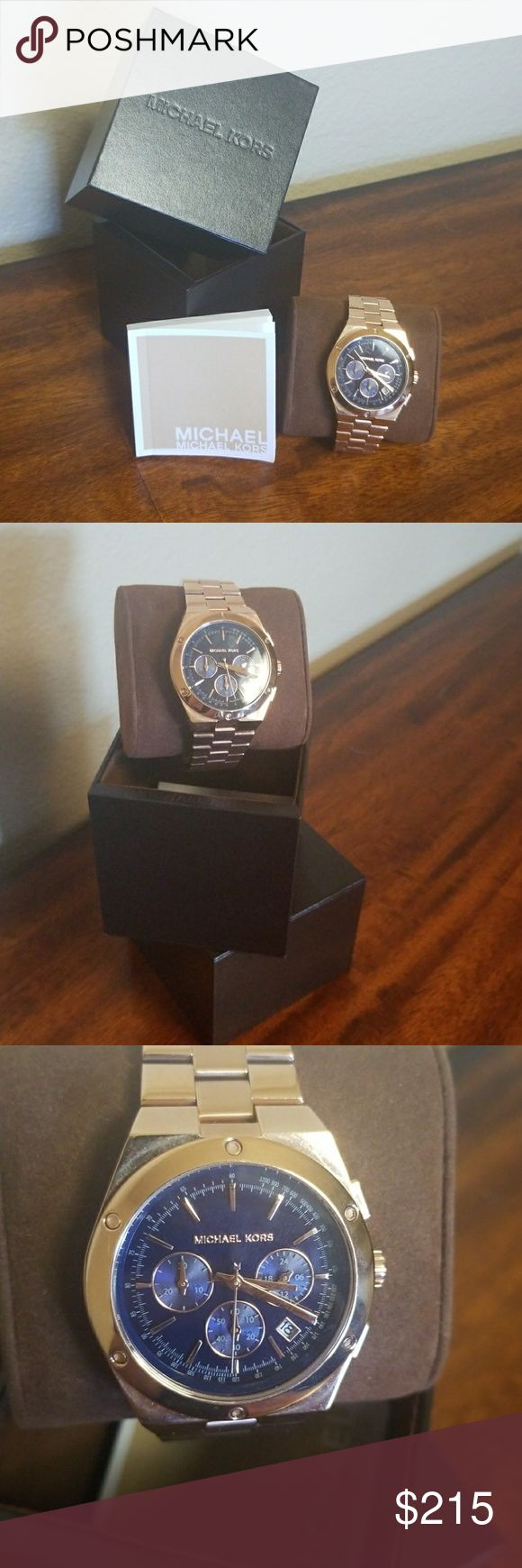 Michael Kors Men's watch This watch has never been worn before. It is rose gold with a navy blue face. Has a instruction manual. It has a chronograph minute hand, a 24 hour hand and also a chronograph second hand. It also has a date fixture. Michael Kors Accessories Watches