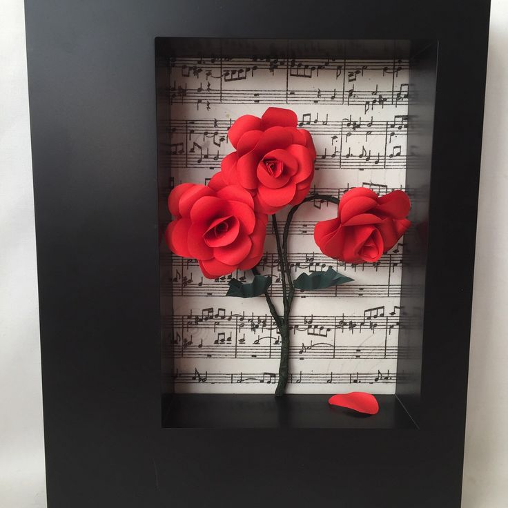 A personal favourite from my Etsy shop https://www.etsy.com/uk/listing/268459302/red-paper-roses-in-box-frame-home-decor