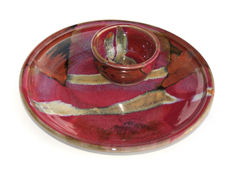 Chez Red / temoky: serving platter with dip bowl - Glossy copper red glaze. Deep tones spanning from copper/rust to venetian reds.  Partnered with a matt brown, with lines of black where the glaze breaks on the edges.