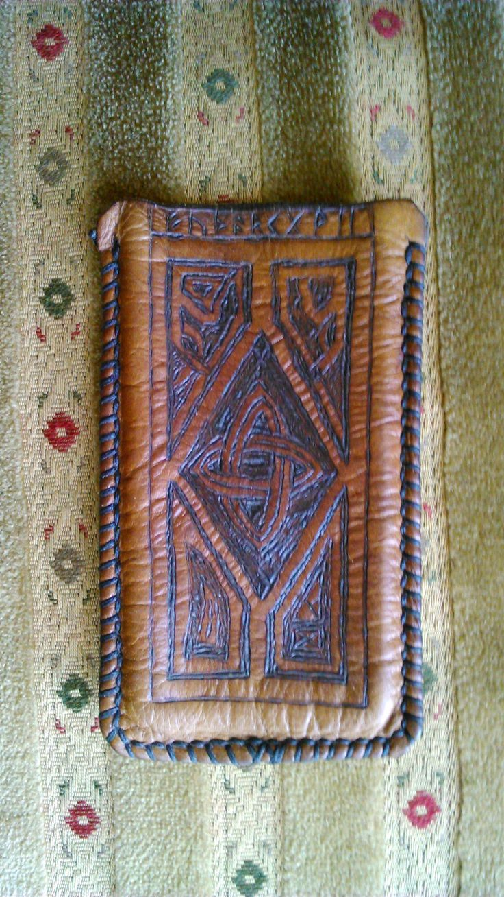 A leather phone holder with Viking motive. Handmade by Paweł Wodziński