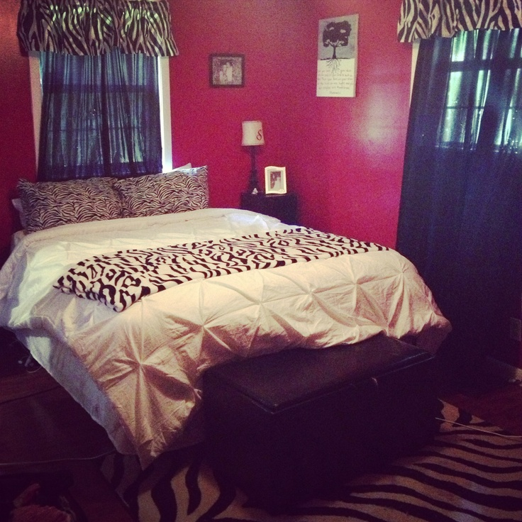 Red and zebra bedroom decor.