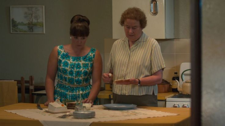 Delia Busby's blue floral dress in Call The Midwife (Series 6, Episode 2)