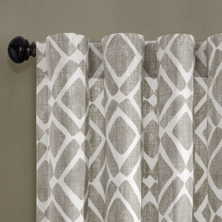 """Our Madison Park Delray Diamond Window Curtain revitalizes your home with modern style and color. A printed diamond motif is featured in a neutral grey, for the perfect update to any room. Made from a cotton twill blend, this window panel has a soft textured feel, creating a natural allure that complements any room. Simply hang on rod pocket or back tabs for a simple finish; fits up to a 1.25"""" diameter rod."""