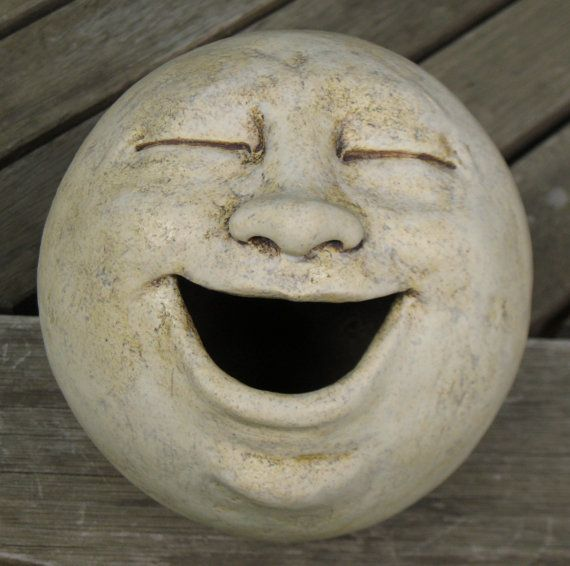 laughing garden sculpture, clay. (plant something in the mouth?)