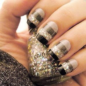 These would be great nails for a New Year's event! Use tape to achieve this look. If you have short nails, you can either collapse the width of the lines or eliminate one of the lighter colors on bottom. Alternatively, you could layer the lines with a light color on the tip and a thin layer of black next to the glitter block.