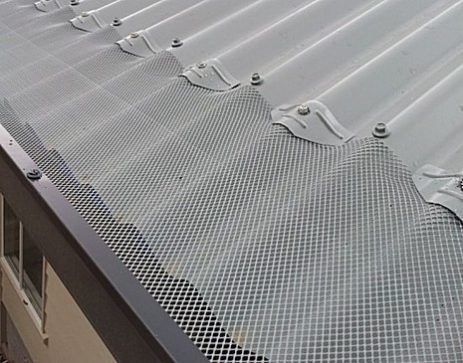Aluminium gutter mesh installed on a tin roof. Protect your gutters from leaves.