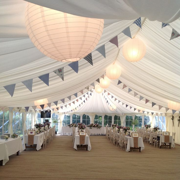 Beautiful lilac bunting gives the finishing touch to this beautiful country wedding marquee..