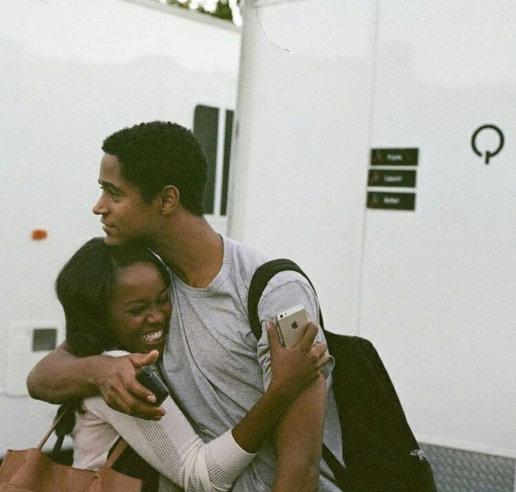 Alfie Enoch and Aja Naomi King hugging on the set of How To Get Away With Murder