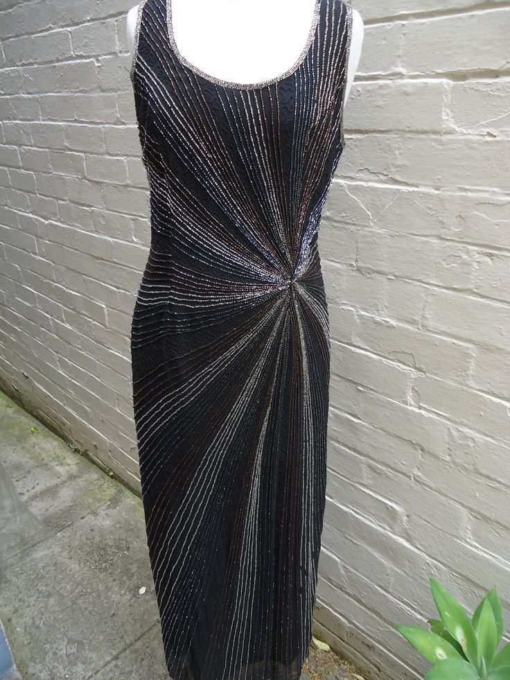 1980's does Art Deco in a superb Laura K beaded gown featuring star-burst bugle beads! Size 10 $149 SOLD