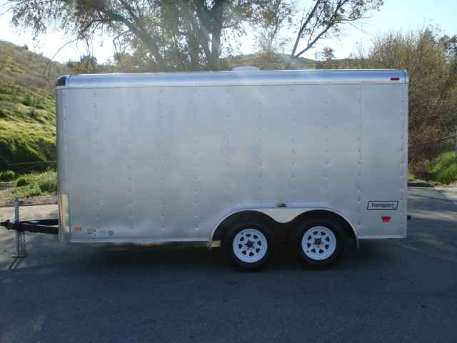 2016 New Haulmark TS7X14DT2 Toy Hauler in California CA.Recreational Vehicle, rv, 2014 HAULMARK TS7X14DT2, Transport DLX Steel Frame Tag Round Front Round Roof 14ft Long 7ft Wide 2-5/16in 10,000lb Coupler (1 EA) 2in x 4in Tube Main Rails Crossmembers 24in On Center Z Crossmembers Standard Height Vertical Posts 16in On Center 72-3/4in Z Posts (1 EA) Roof Bows 24in On Center Tube Roof Bows Standard A-Frame Tongue 7,800lb Silver Safety Chains w/Gold Hook (1 PR) Sand Pad (1 EA) 2,000lb Top Wind…