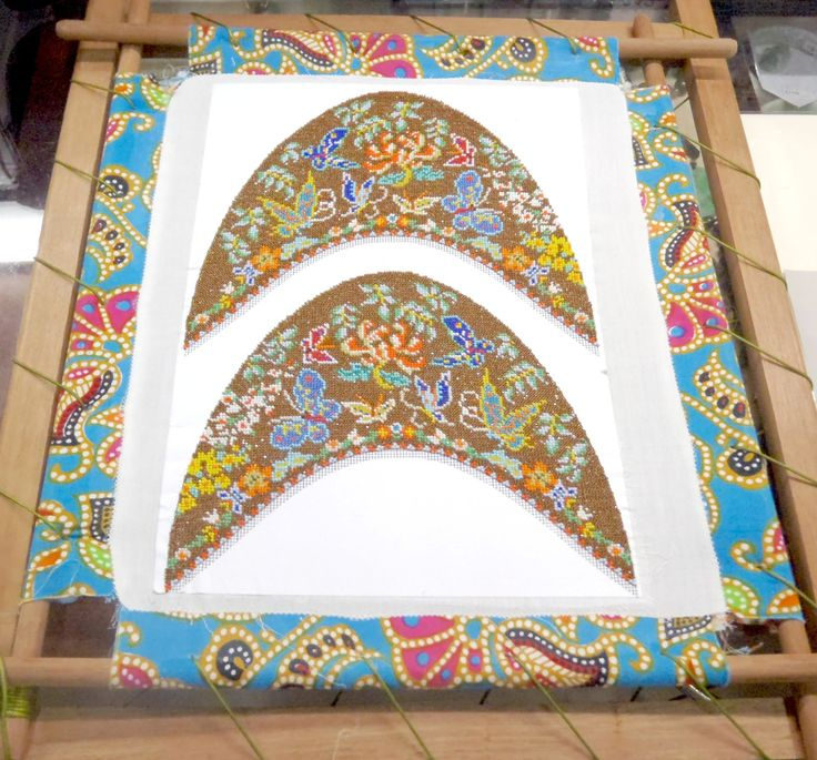 frame containing the canvas on which the front of the beaded slippers are made #Peranakan #beadedslippers #stretchframe #Singapore