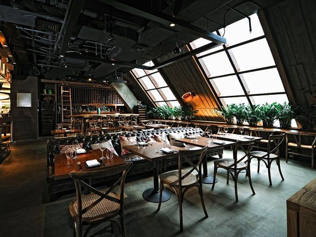 """Bouquet 璞恪•香源, French fusion in Jing'an area. This secluded wine bar is set in the attic of a bookstore and features 100 wines on the list  but just 50 seats. Their menu of small """"global plates"""" that includes pizza and charcuterie options is put out by chef Rafael Qing, formerly of MAYA."""