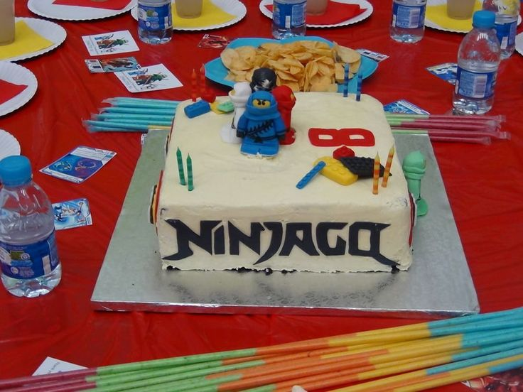 Lego Ninjago Birthday Cake with:    Ninjago figurines  Ninjago logo  lego blocks