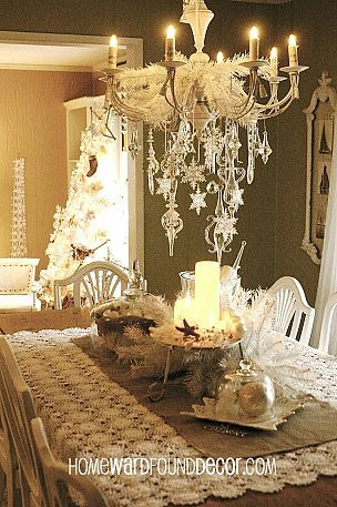 Beautiful white Christmas decor... i love the snowflakes hanging from the chandelier