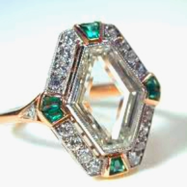 Table-cut portrait diamond ring with emeralds.