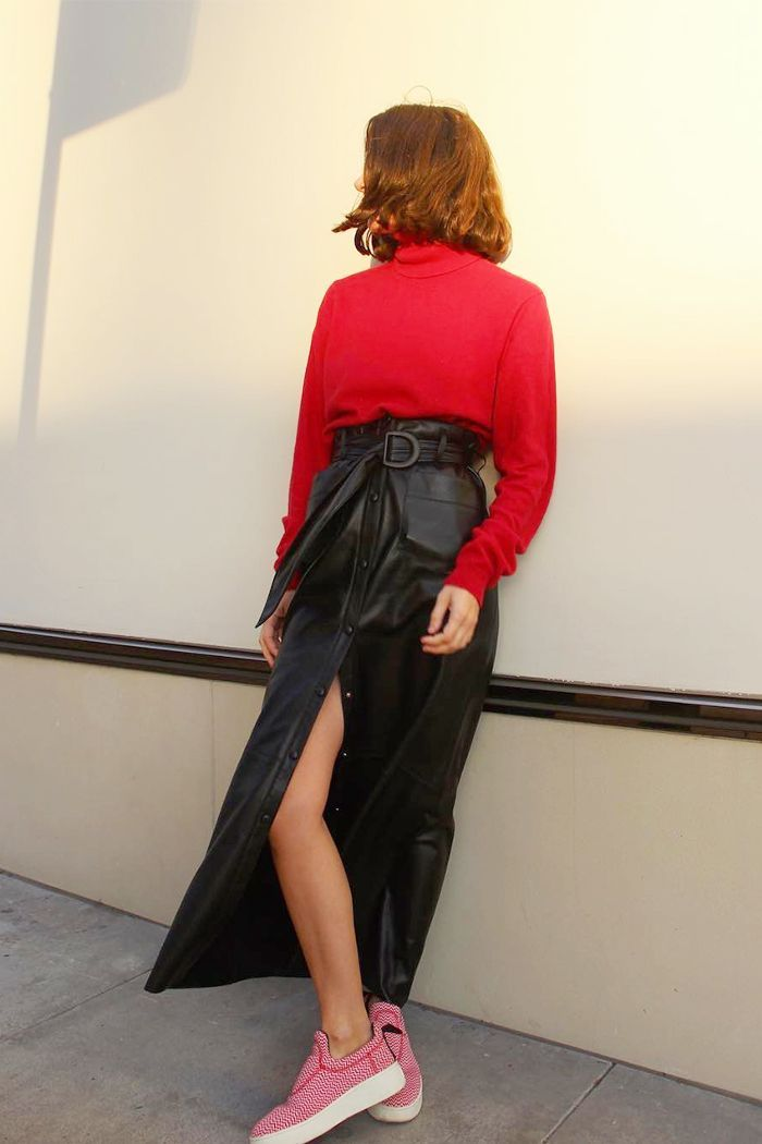 Whether paired with a coordinating crop top or tucked over a cozy knit, see the high-waisted skirt outfits we're loving.