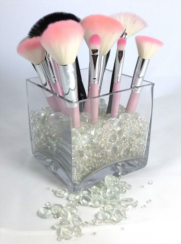 Organizing Makeup Brushes... Glass container with pebbles looks (how mine is) way nicer than having them shoved in a bag
