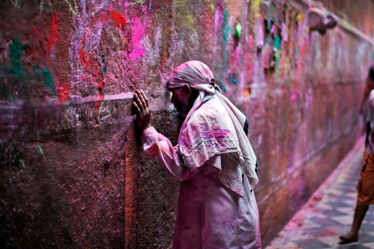 An Indian devotee rests his forehead in an act of respect on the wall of the Banke Bihari temple during Holi celebrations in Vrindavan, India, March 27, 2013. (Altaf Qadri /Associated Press - See more at: http://www.boston.com/bigpicture/2013/04/holi_celebrations.html#sthash.OoWU0A9j.dpuf )