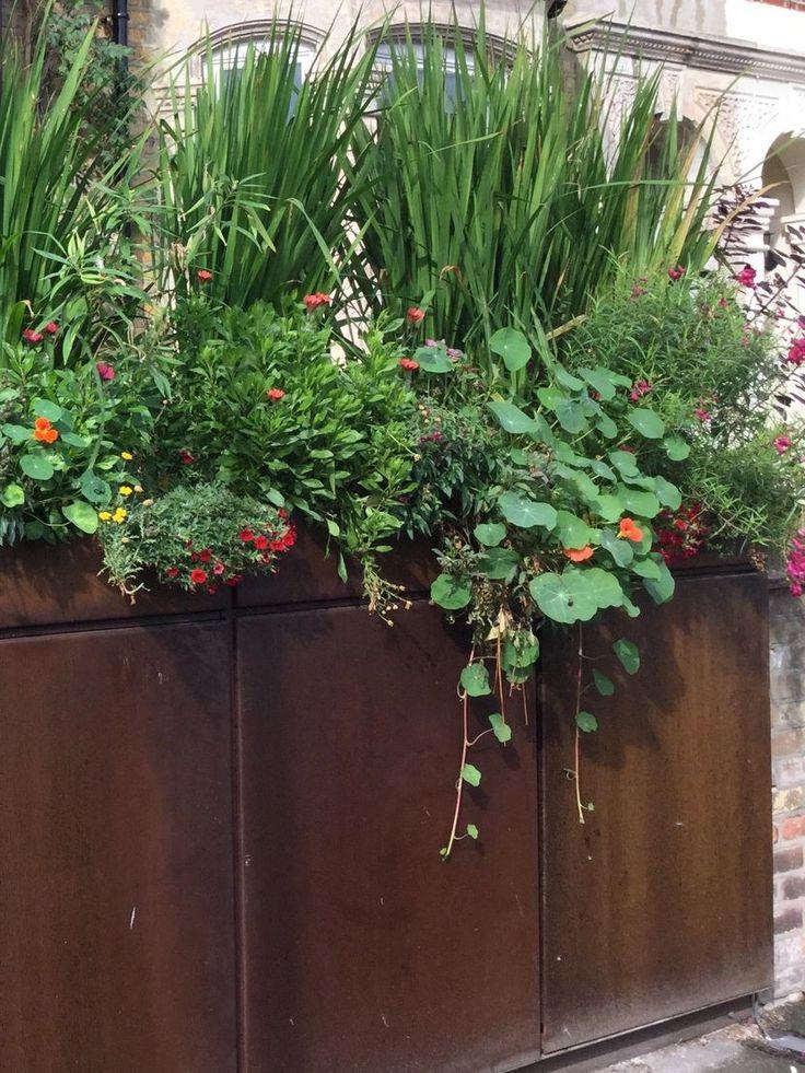 replace Garden wall with bike bin storage