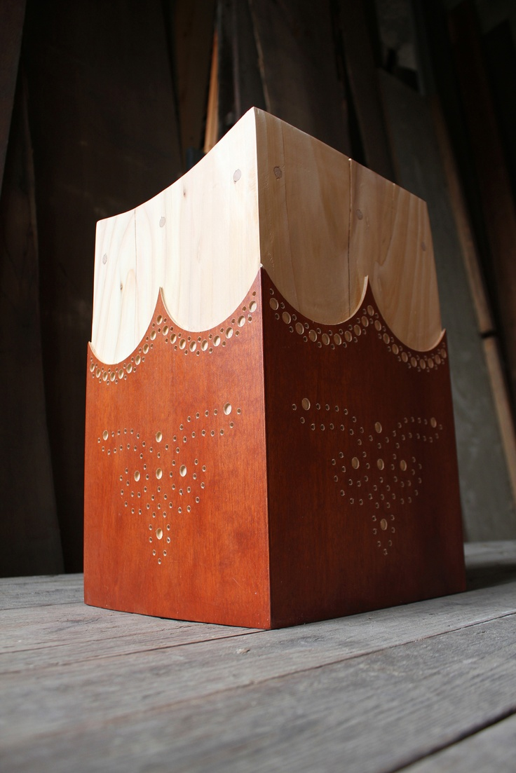 Dandy stool  A solid wooden stool made of scented cedar wood, adorned in walnut.  Inspired by the traditional skill of a shoemaker's brogue pattern,  modernized in a new fashion. A dignified piece with the elegance, style  and poise of an English dandy.