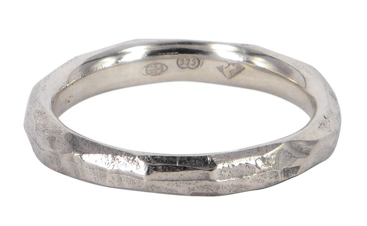Very thin explosion wedding ring in 9ct white gold