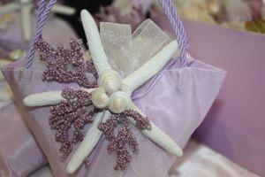 Sacchetto per confetti con stella marina per le bomboniere del matrimonio