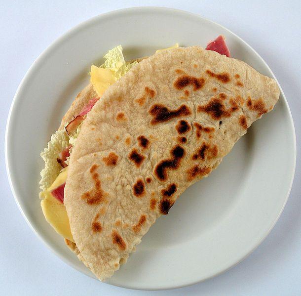 A piadina, a dish characteristic of San Marino and its surrounding Italian region, Romagna.