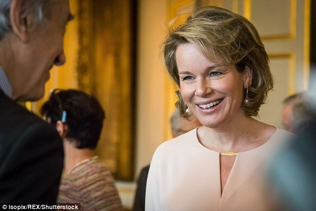 Mathilde looked in good spirits as she chatted to guests following the official ceremony ...