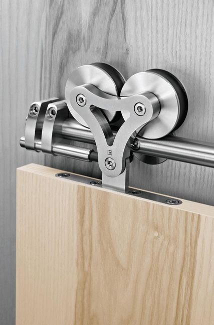 If you want a modern look for your sliding barn doors, try this! Duplex-S by Supra: Stainless steel sliding door hardware - beautiful design!