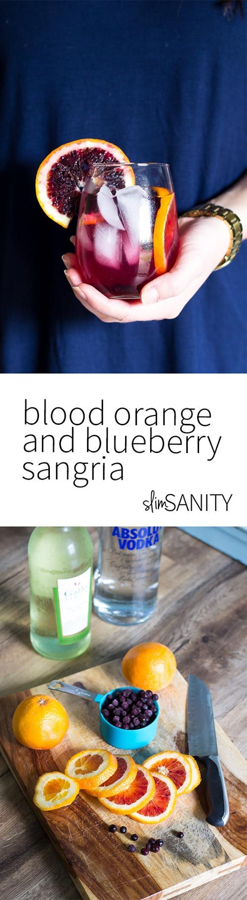 Blood orange and blueberry sangria is a simple party drink made with fruit, sauvignon blanc, vodka and a little bit of club soda.   slimsanity.com