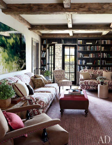 sofas, covered in a Clarence House print; the armchair is clad in a Brunschwig & Fils faux suede, and the carpet is by Stark.