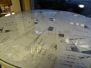 photocopied the envelopes in black and white and laid the copies underneath the glass