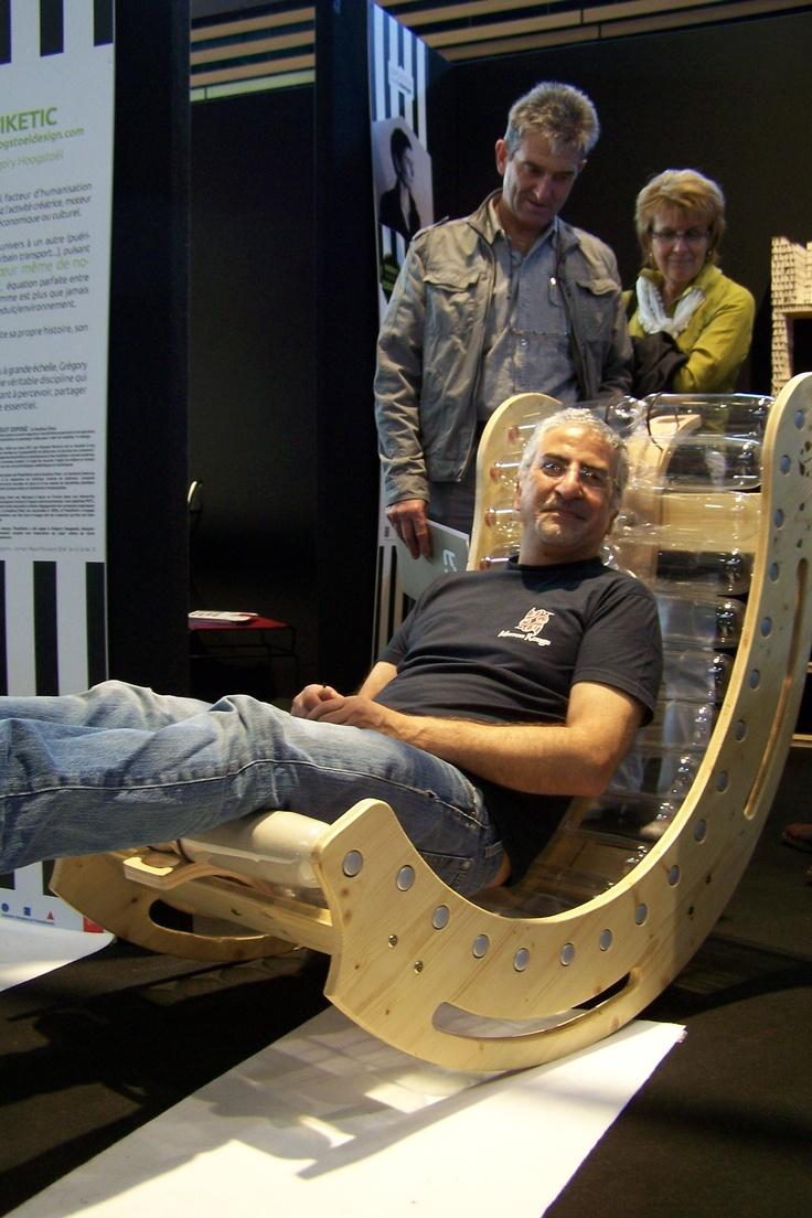 Salon Home 2012 : Marron-Rouge sitting on  KusKus Chair