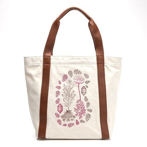 Made with 100% unbleached cotton canvas, this carryall tote is embroidered with floral detail, designed by Pearl & Marmalade, a Chicago-based...