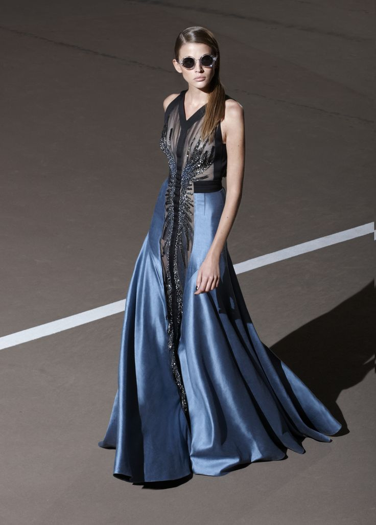 Floor length blue evening gown with black detailing