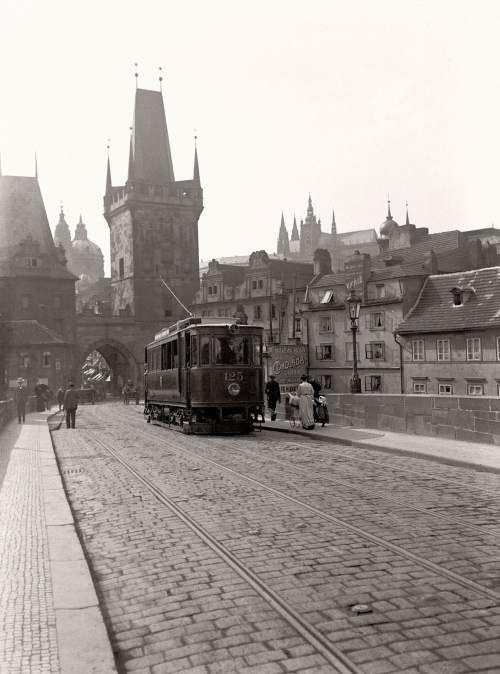 A tram crosses Prague's famous Charles Bridge (Karlův most) in this photo by Jan Srp from 1908.