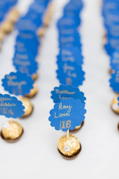 Edible wedding escort card idea - blue + gold cards with chocolate truffles {Candice Adelle Photography}