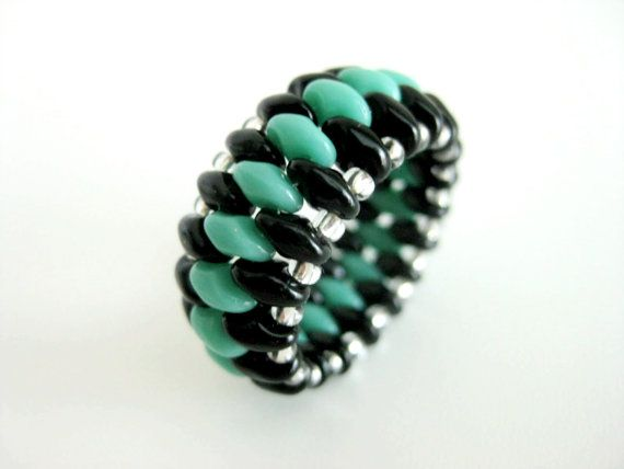 A gorgeous peyote ring! Made of Czech super duo beads in black and turquoise green and Japanese seed beads in silver lined crystal.  The ring is 3/8(1,1cm) wide and size 7 (54-55).  It is very comfortable to wear and lightweight.  Check out my other beaded rings in many different colors, styles and designs: http://www.etsy.com/shop/MadeByKatarina?section_id=5864177  Thank you for looking and have a great day
