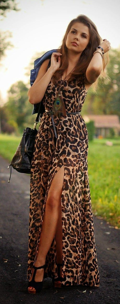 Shop this look on Lookastic:  https://lookastic.com/women/looks/denim-jacket-maxi-dress-heeled-sandals-crossbody-bag-belt-bracelet-pendant/13059  — Black Bracelet  — Blue Denim Jacket  — Brown Pendant  — Black Leather Belt  — Black Suede Heeled Sandals  — Black Leather Crossbody Bag  — Brown Leopard Maxi Dress
