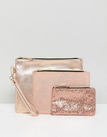 Glitter And Metallic Pouches by Oasis. Pouches set by Oasis, Pack of three, Stock up, Glitter and metallic designs, It's time to shine, Zip-top closure. Creating collections with focus on feminine tailoring, quality cuts and wearable designs, high street brand Oasis deliver e... #oasis #bags