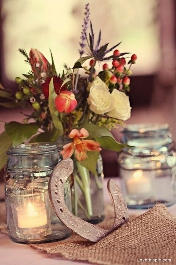 rustic wedding horseshoe wedding centerpiece with burlap and mason jars / http://www.deerpearlflowers.com/rustic-farm-wedding-horseshoe-ideas/