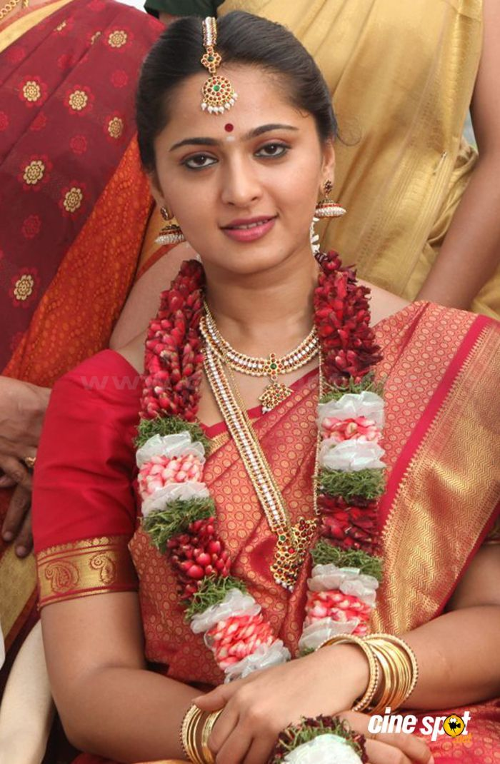 South Indian bride. Temple jewelry. Jhumkis.Red silk kanchipuram sari.Braid with fresh jasmine flowers. Tamil bride. Telugu bride. Kannada bride. Hindu bride. Malayalee bride.Kerala bride.South Indian wedding. Anushka Shetty.